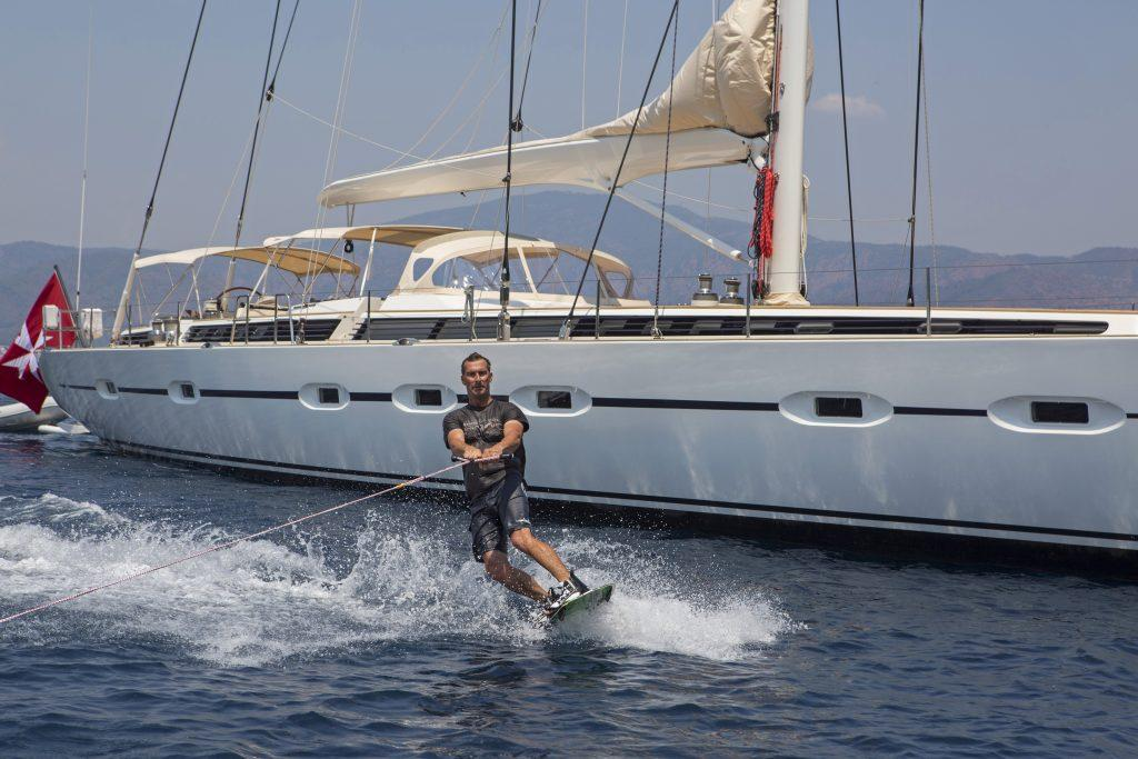 Sailing yacht with water-skier