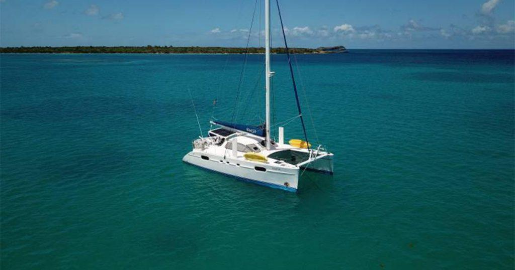 47' charter catamaran GENESIS offers private yacht charters in the Caribbean. Discounts offered for April and May 2021 for Antigua holidays. Photo taken March 2021.